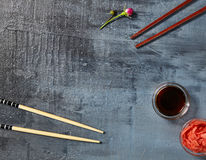 Cappamaki Sushi Roll with Soy Sauce and Ginger over Stone Backgr Stock Image
