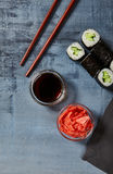 Cappamaki Sushi Roll with Soy Sauce and Ginger over Stone Backgr Stock Images