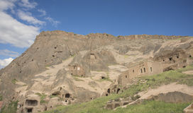 Capped earth pillarsand houses , Aksaray province, Turkey Royalty Free Stock Images