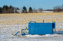 Capped Gas Well. Blue Metal Capped Gas Well in Rural Winter Field Royalty Free Stock Photo