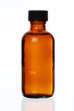 Capped Generic Medicine Bottle. Isolated Generic Brown Glass Bottle, Against White, Bit of Reflection royalty free stock image