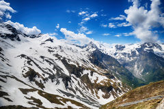 Capped mountain peaks Stock Images