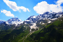 Capped mountain peaks Stock Photography