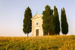 Cappella Madonna di Vitaleta Tuscany Sunset. Cappella Madonna di Vitaleta on a Tuscan summer`s afternoon, shown with golden fields of hay stock photos