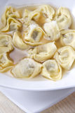 Cappelletti in broth, typical Italian pasta Royalty Free Stock Image