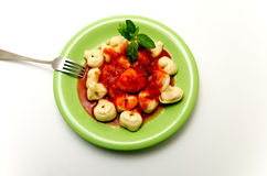 Cappelletti. Pasta stuffed served with tomato sauce Stock Image