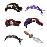 Cappelli del pirata del fumetto, sciarpe con i crani e un coltello Fotografia Stock