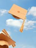 Cappelli di laurea di tiro Fotografia Stock