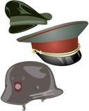 Cappelli e casco militari Fotografie Stock