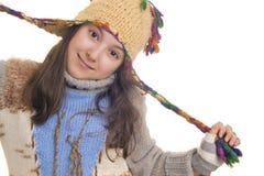 Cappello d'uso e guanti della bella ragazza Fotografie Stock