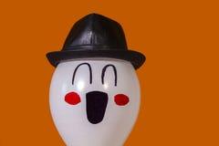 Cappello d'uso sorridente del pallone Fotografia Stock