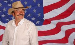 Cappello da portare dell'uomo sulla bandierina degli Stati Uniti Fotografia Stock