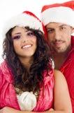 Cappello da portare di natale delle giovani coppie amorous Immagini Stock