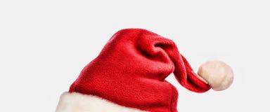Cappello del Babbo Natale isolato su fondo bianco Fotografie Stock Libere da Diritti