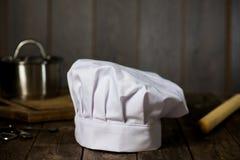 Cappello del cuoco unico con gli ambiti di provenienza Fotografie Stock