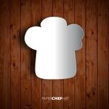 Cappello del cuoco unico di Papercut su fondo di legno Immagine Stock Libera da Diritti