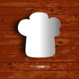 Cappello del cuoco unico di Papercut su fondo di legno Fotografia Stock