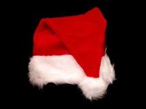 Cappello della Santa di natale sul nero immagine stock libera da diritti