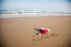 Cappello della Santa sulla spiaggia Fotografie Stock