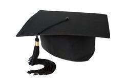 Cappello di graduazione su priorità bassa bianca Immagine Stock Libera da Diritti