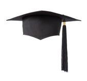 Cappello di graduazione su priorità bassa bianca Immagine Stock