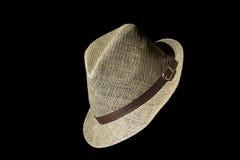 Cappello di paglia casuale su fondo nero Immagine Stock
