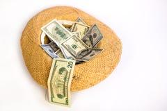 Cappello di paglia con i dollari Immagine Stock Libera da Diritti