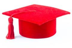 Cappello di rosso di graduazione Fotografie Stock