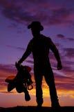 Cappello di usura della sella del cowboy dell'uomo della siluetta Immagini Stock Libere da Diritti