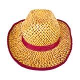 Cappello di vimini sui precedenti bianchi Immagini Stock