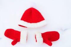 Cappello e guanti Colori rossi di Natale fotografia stock libera da diritti