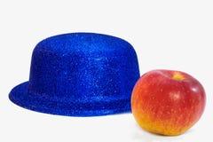 Cappello e mela Fotografia Stock