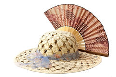 Cappello e ventilatore di paglia. Immagini Stock