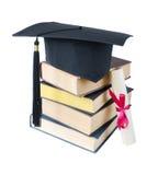 Cappello, libri e rotolo laureati Fotografia Stock Libera da Diritti