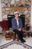Cappello maggiore maturo del Babbo Natale di natale della donna Fotografie Stock Libere da Diritti