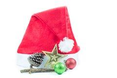 Cappello rosso di Santa Claus su un fondo bianco Fotografia Stock Libera da Diritti