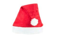 Cappello rosso di Santa Claus su un fondo bianco Fotografia Stock