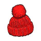 Cappello tricottato inverno rosso luminoso con il fiocchetto Fotografie Stock Libere da Diritti