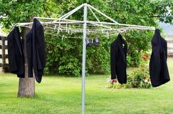 Cappotti dello smoking su un Clothesline Fotografia Stock