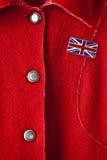 Cappotto rosso della signora Immagini Stock