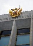 Cappotto russo dell'aquila dorata delle braccia Fotografie Stock