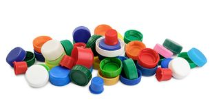 Cappucci di plastica dell'animale domestico per il riciclaggio sul bianco fotografia stock libera da diritti