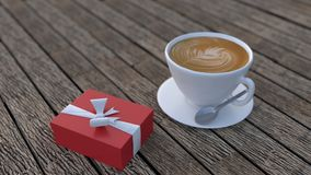 Cappuccino και κόκκινο κιβώτιο δώρων Χριστουγέννων Στοκ φωτογραφία με δικαίωμα ελεύθερης χρήσης