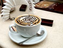 Cappuccino. Cup of cuppucino with decorative meerschaum Royalty Free Stock Image