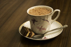 Cappuccino. Italian cappuccino with chocolate cake royalty free stock image