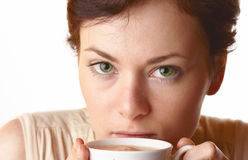 Cappuccino. Young woman cappuccino drinking from a cup. Isolated Stock Images