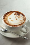 Cappuccino. Hello kitty cup on marble table Royalty Free Stock Photo