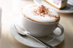 Cappuccino. Served in a coffee shop Royalty Free Stock Photography