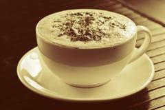 Cappuccino. A cappuccino coffee on a saucer in sepia tone Stock Photo