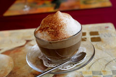 Cappuccino. The cappuccino at restaurant in the evening Stock Photography